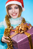 Festive girl with Christmas gift Stock Photo