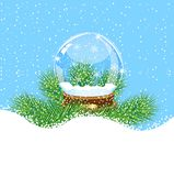 Festive glass ball with the branches of fir-tree on to snow Stock Images