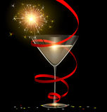 Festive glass and sparkler Stock Photo