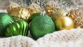 Festive glitter Christmas balls on soft woolen blanket Stock Photo
