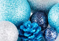 Festive glitter christmas decoration silver blue. Traditional festive christmas decoration glitter in silver and blue Royalty Free Stock Photos