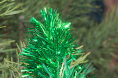 The festive glitter ornaments on the Christmas tree in front of the holiday. royalty free stock images
