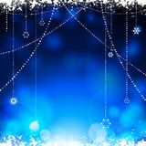 Christmas glowing blue background with hanging stars. Festive Glowing Blue Christmas Background with Snow and Hanging Stars Decorations Stock Image