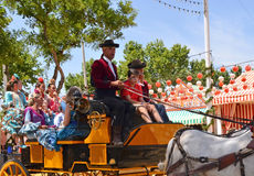 Festive-goers on horse carriage during Seville Spring Festival 201 Royalty Free Stock Photos