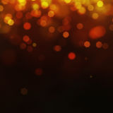Festive gold background. Gold Festive Christmas background. Elegant abstract background with bokeh defocused lights and stars Royalty Free Stock Photo