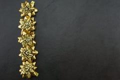 Festive gold bows Stock Photos