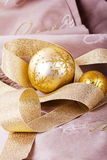 Festive gold Christmas decorations on fabric background Stock Images