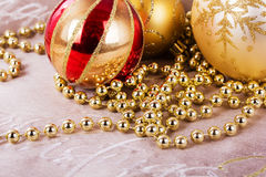 Festive gold Christmas decorations on fabric background Stock Photography