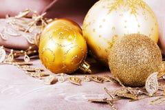 Festive gold Christmas decorations on fabric background Stock Image