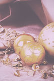 Festive gold Christmas decorations on fabric background Vintage Stock Photo