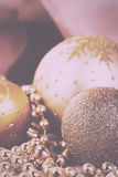 Festive gold Christmas decorations on fabric background Vintage Stock Photos