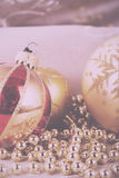 Festive gold Christmas decorations on fabric background Vintage Stock Image