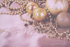 Festive gold Christmas decorations on fabric background Vintage Royalty Free Stock Images