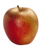 Festive gold-plated apple with water droplet stock photo