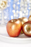 Festive golden apples  on glitter red background Stock Image