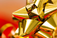 Festive golden bow on a blurred background. macro Royalty Free Stock Images