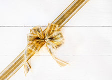 Festive golden bow with copyspace Stock Images