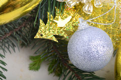 Festive golden christmas decoration, candles, white balls, green fir tree branch Stock Image