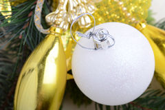 Festive golden christmas decoration, candles, white balls, green fir tree branch, closeup Royalty Free Stock Photo