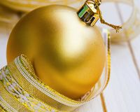 Festive golden Christmas decorations Stock Photos