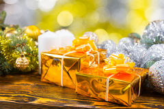 Festive Golden Gifts on Table with Decorations Royalty Free Stock Photo