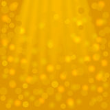 Festive golden square background with beams and bokeh Royalty Free Stock Photography