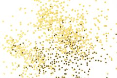 Festive golden stars of confetti on a white background. Group of gold star decoration object design. Top view royalty free stock photography