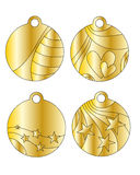 Festive golden tags. With stars and hearts Stock Images