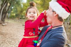 Festive Grandfather and Mixed Race Baby Girl Outdoors. Festive Grandfather and His Mixed Race Baby Girl Outdoors stock photography