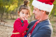 Grandfather and Mixed Race Baby Girl Outdoors. Festive Grandfather and Mixed Race Baby Girl Outdoors royalty free stock images