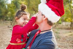 Fun Grandfather and Mixed Race Baby Girl Outdoors. Festive Grandfather and Mixed Race Baby Girl Outdoors royalty free stock images
