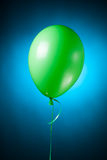 Festive green balloon Stock Images