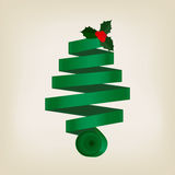 Festive green Christmas tree of coiled ribbon. In a spiral cone topped with a sprig of leafy green holly with red berries on a grey background,  design element Royalty Free Stock Images