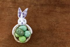 Festive Green Easter Eggs In The Basket On Orange Background Royalty Free Stock Photo