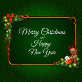 Festive greeting card with Golden frame and. Christmas decoration on a green background Stock Photos