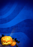 Festive Halloween background. Halloween background of jack-o'-lanterns and bats on blue background. Good for creating flyers, brochures, party invitations, and Stock Images