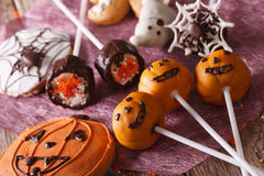 Festive Halloween cake pop and gingerbread close-up. horizontal Stock Images
