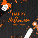 Festive Halloween card template. Top view on spiders, paper bats and confetti on dark wooden texture. Vector illustration with black gift box in the form of Stock Photo