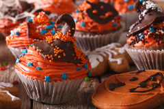 Festive Halloween cupcakes with chocolate witches hat close-up Stock Images