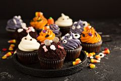Festive Halloween cupcakes and treats royalty free stock image
