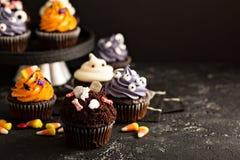 Festive Halloween cupcakes and treats royalty free stock photos