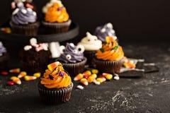 Festive Halloween cupcakes and treats stock photo
