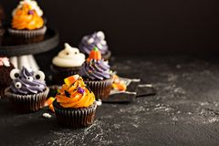 Festive Halloween cupcakes and treats stock photos