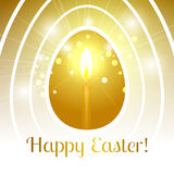 Festive Happy Easter greeting card with stylized Golden egg with. A candle inside that emits light rays and bokeh particles and it`s all inside a set of white Royalty Free Stock Photos