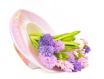 Festive hat with fresh spring hyacinthes. On white background Stock Photo