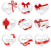 Festive heart-shaped  cards with red gift ribbons. Set of beautiful heart-shaped cards with red gift bows with ribbons. Vector illustration Royalty Free Stock Photography