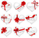 Festive heart-shaped  cards with red gift ribbons Stock Image