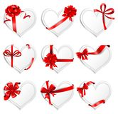 Festive heart-shaped  cards with red gift ribbons. Set of beautiful heart-shaped cards with red gift bows with ribbons. Vector illustration Royalty Free Stock Photos