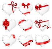 Festive heart-shaped  cards with red gift ribbons. Set of beautiful heart-shaped cards with red gift bows with ribbons. Vector illustration Stock Image