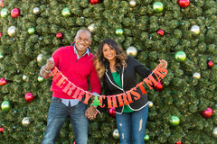 Festive holiday couple shopping Stock Photo